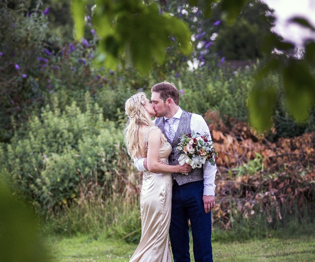 Shot of couple through branches