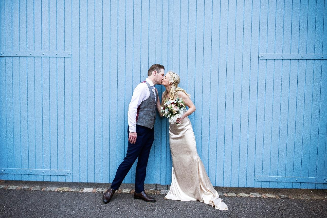 Couple with barn door backdrop
