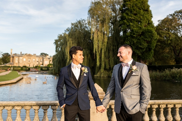 Couple pose on bridge