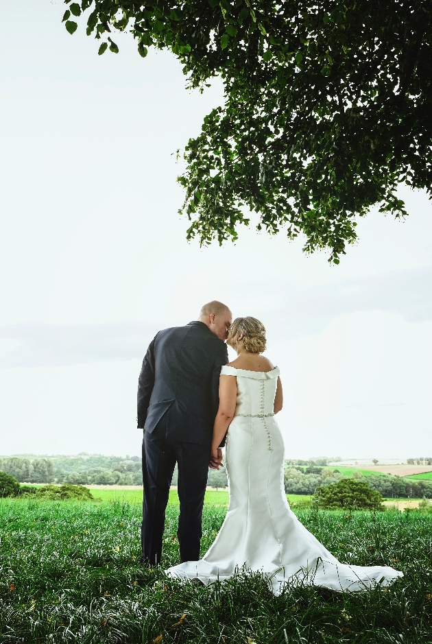 Couple looking out into field
